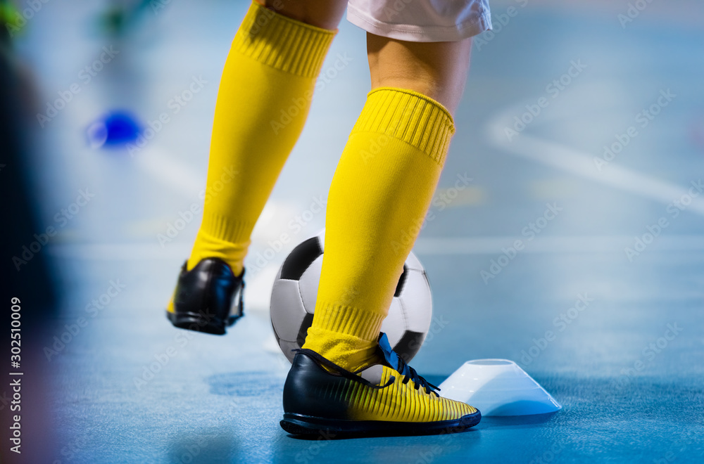 Fototapety, obrazy: Futsal soccer training. Single young futsal player with ball on training. Close up of legs of futsal footballer. Indoor european football practice unit