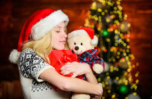 Santa Hat Christmas Accessory. Cute Gift. Winter Holidays Celebration. Happy New Year. Xmas Mood. Christmas Preparation. All She Wants For Christmas. Cheerful Woman. Woman Got Teddy Bear Toy Present