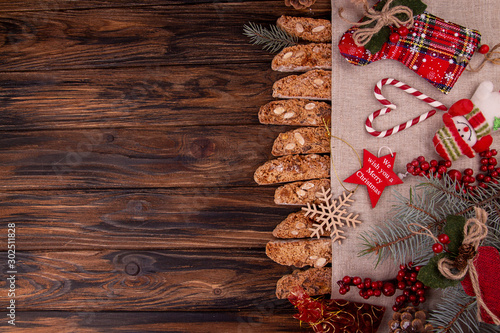 Cuadros en Lienzo  Traditional italian Christmas New Year dry cookies biscuits biscotti cantuccini in glass bowl on wooden background