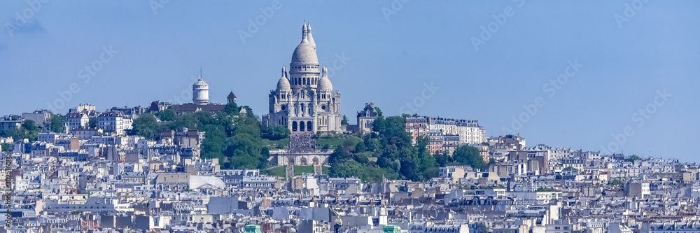Fototapeta Paris, panorama of the city, typical roofs and buildings, with Montmartre and the Sacre-Choeur basilica in background
