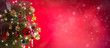 Leinwanddruck Bild Christmas and New Year background. Pine tree and Christmas decorations on red bokeh background