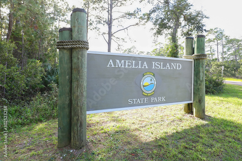 Photo Amelia Island State Park sign, Amelia Island State Park is a public park with 200 acres of unspoiled wilderness and the only Florida State park that offers horseback riding on the beach