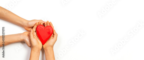 Canvastavla  Hands holding red heart over white background