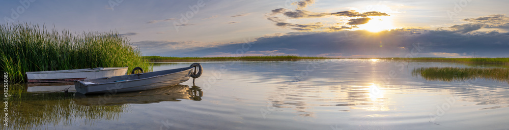 Fototapety, obrazy: The fishing boats in the sunset light on the lake Naroch, Belarus