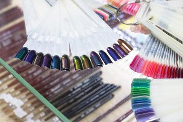 Multicolored nail polish on artificial plastic nails