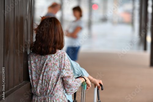 A young woman and her accompanist are waiting for their train at a railway station in Beau-Japan Canvas Print