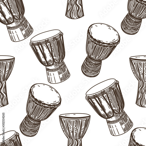 Photo Vector hand drawn seamless pattern of African drums in the style of engraving on white background
