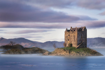 Fairytale Castle surrounded by water in the Scottish Highlands