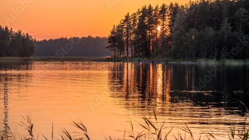 Sunset on lake in summer