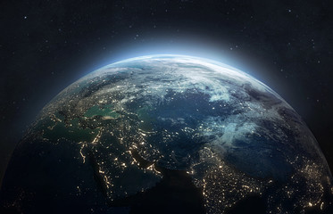 Nightly planet Earth in dark outer space. Civilization. Elements of this image furnished by NASA