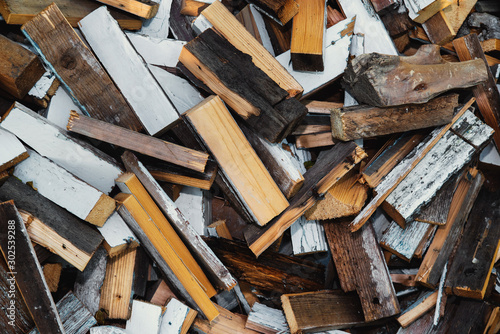 Tuinposter Brandhout textuur Sawn boards and firewood