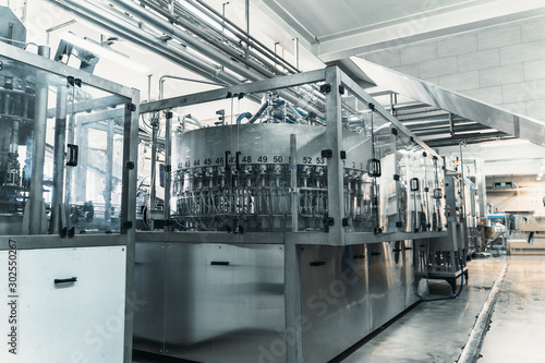 Obraz Industrial machine in beverage plant or factory interior, industry equipment, toned - fototapety do salonu