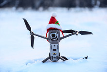Drone In Santa Clause Hat On Snow