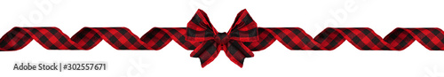 Obraz Long Christmas border of red and black buffalo plaid bow and ribbon isolated on a white background - fototapety do salonu