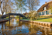 Lovely Canal With Wooden Bridg...