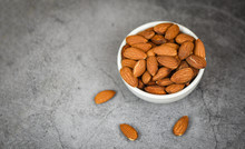 Almonds Bowl On Gray Background / Close Up Almond Nuts Natural Protein Food And For Snack