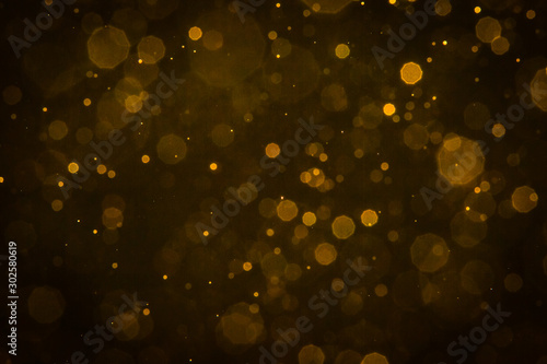 Fotomural  Abstract blur gold sparkle bokeh