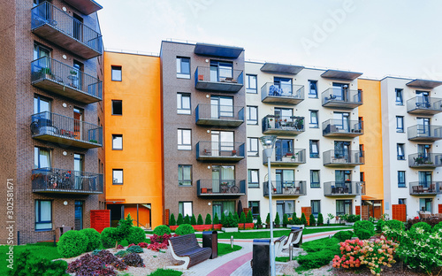 Leinwand Poster Modern residential apartment with flat building exterior with outdoor facilities