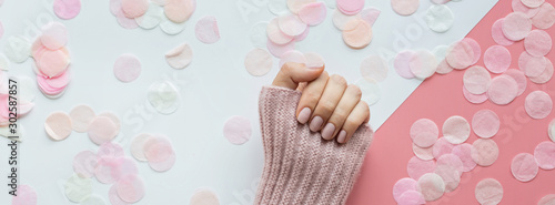 Foto op Aluminium Manicure Stylish trendy female pink manicure. Beautiful young woman hands on pink and white background with flowers and place for text. Minimal creative concept. Flat lay, top view, mock up copy space template