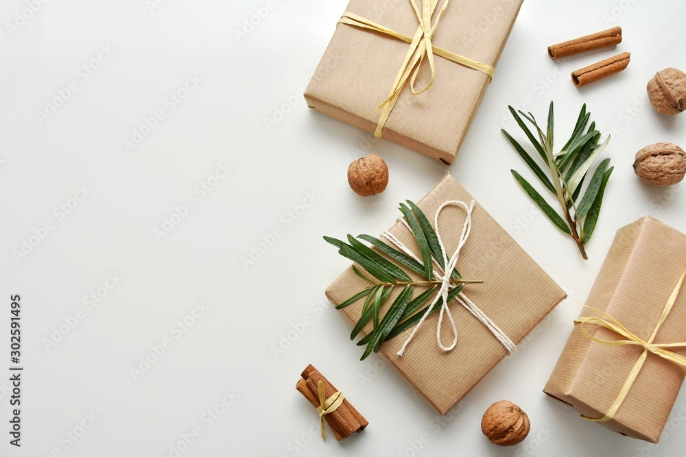 Fototapeta Zero waste gift wrapping with craft paper and natural decorations, top view, copy space.