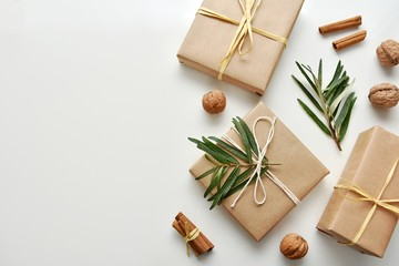 Zero waste gift wrapping with craft paper and natural decorations, top view, copy space.