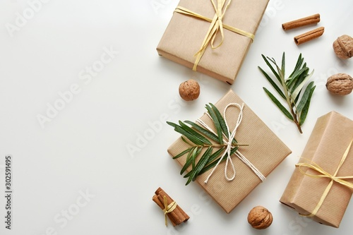 Obraz Zero waste gift wrapping with craft paper and natural decorations, top view, copy space. - fototapety do salonu