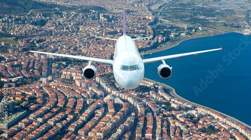 Passenger airplane flying over Izmir City Slika na platnu
