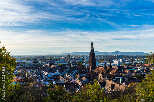 Obraz Germany, Beautiful baden city freiburg im breisgau skyline with houses surrounding ancient muenster cathedral building in beautiful colorful autumn light - fototapety do salonu