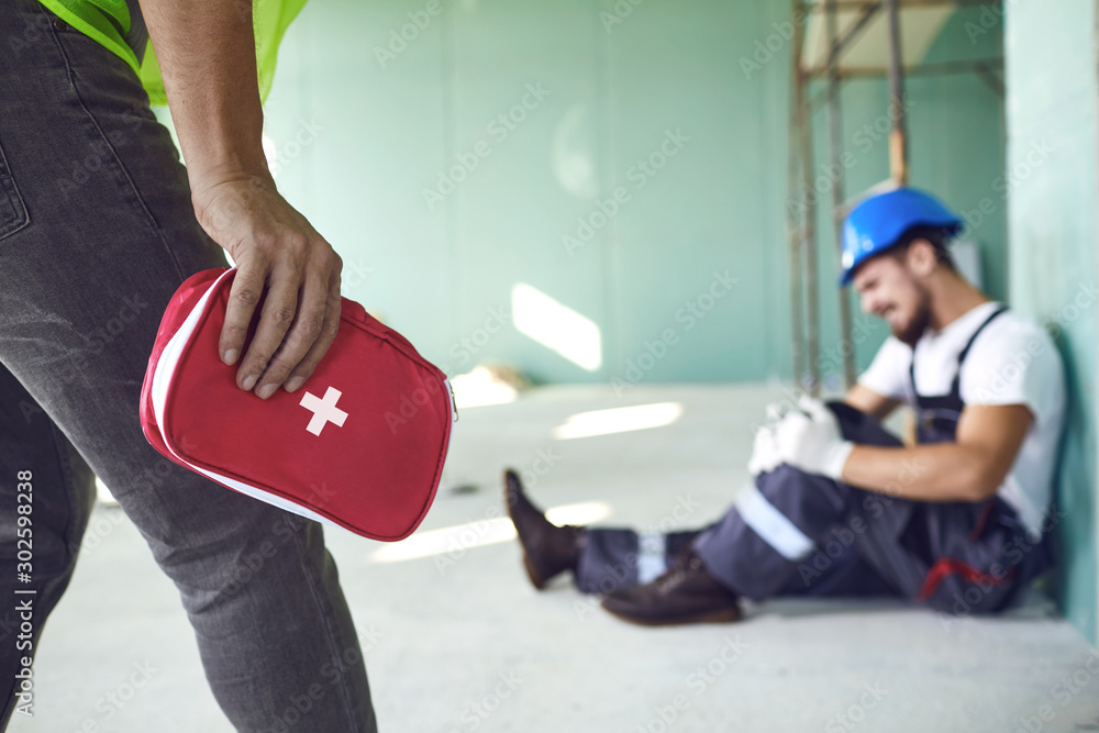 Fototapeta Construction worker accident with a construction worker.