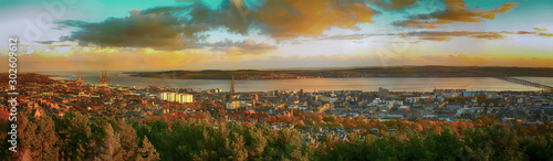 Fotografie, Obraz Colorful Panoramic shot of the Tay Rail Bridge of  Dundee Law in Scotland at twi