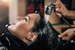 Young Woman Having Hair Washed in Salon