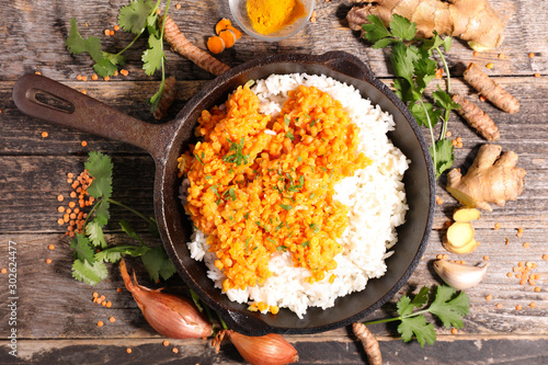 cooking pan with rice and dal indian, top view Canvas Print
