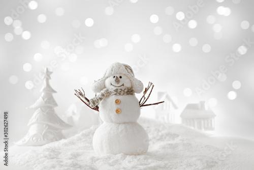Fototapeta christmas snowman on the snow