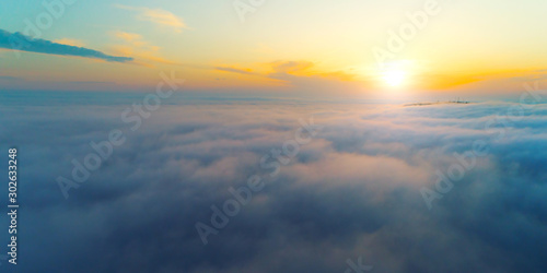 Fotografiet  Beautiful sunset, above clouds. Aerial shot by a drone.