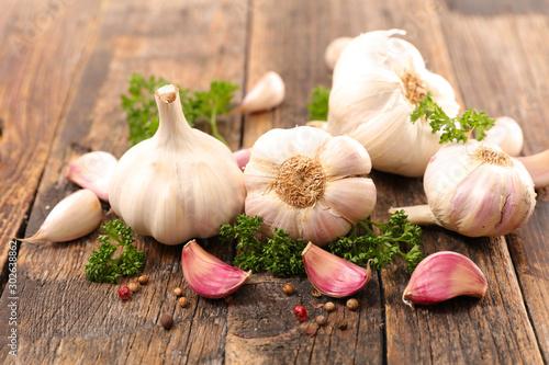 Fototapeta garlic clove with herb and pepper obraz