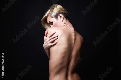 Obraz Female back. Naked beautiful Girl. Short Hair Girl - fototapety do salonu