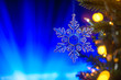 canvas print picture - Christmas toy on the Christmas tree, on dark blue bokeh background,. Horizontal frame