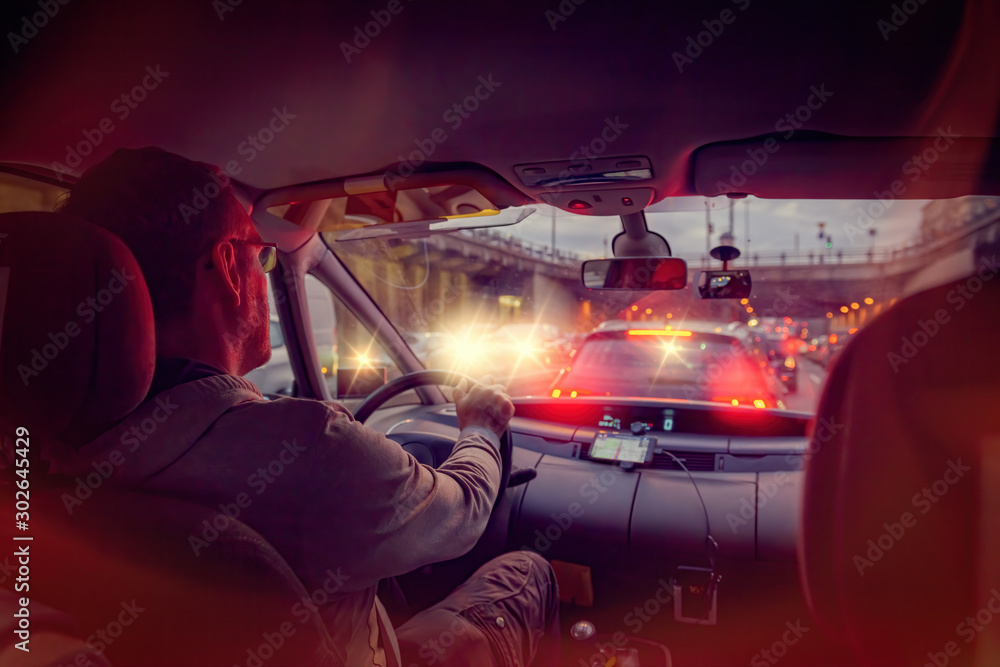 Fototapety, obrazy: Driving a car in the city at night in traffic jams