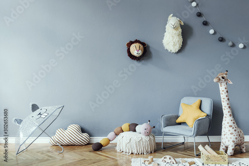 Fototapeta  Stylish scandinavian kid room with toys, teddy bear, plush animal toys, mint armchair, umbrella, cotton balls