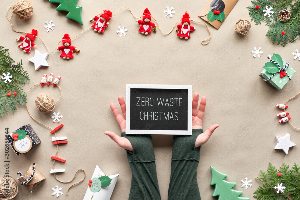 Fototapety, obrazy: Zero waste Christmas, flat lay, top view on craft paper background with textile doll garland, wrapped gifts, black board with text