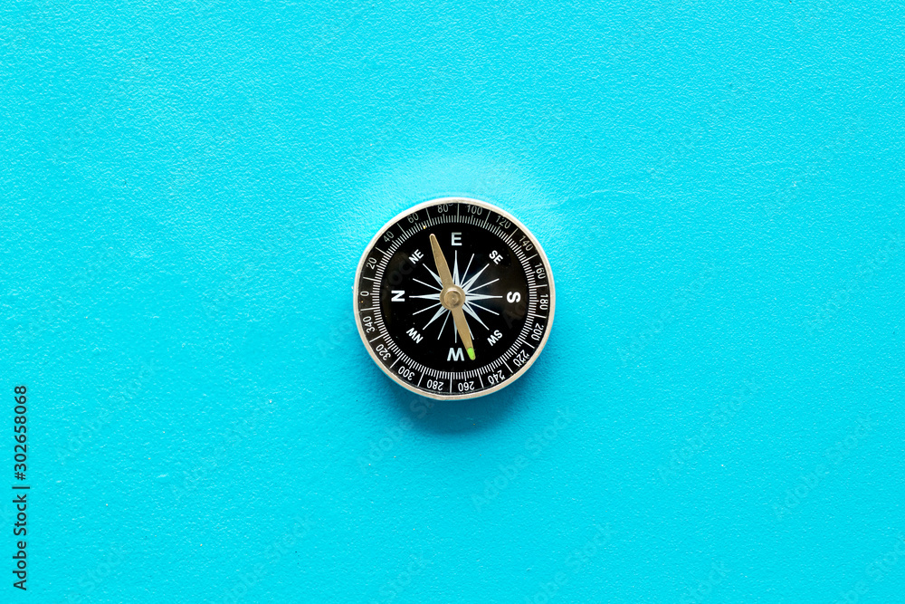 Fototapety, obrazy: Compass - small and stylish - on blue background top view copy space