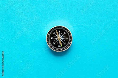 Obraz Compass - small and stylish - on blue background top view copy space - fototapety do salonu