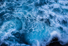 Violent Energetic Waves Crashing On A Rock In Sydney Australia. Light And Dark Blue Water Foaming Whilst Waves Break To The Shore. Deep Sea.