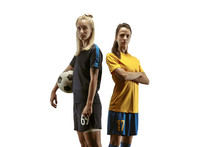 Side To Side. Young Female Soccer Or Football Players In Sportwear And Boots Training On White Background. Concept Of Healthy Lifestyle, Professional Sport, Motion, Movement. Confident Look.