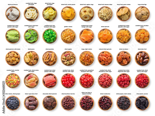 Fototapeta collection candied and dried fruits, sundried berries isolated on white background. dates, pineapple, figs,  apricots, prune, raisins, apples, pears, peach,  plums,  grapes and other organic foods. obraz