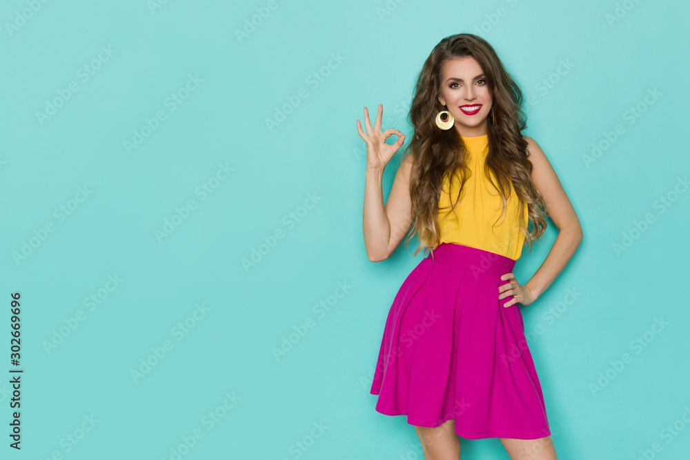 Fototapety, obrazy: Smiling Woman In Colorful Clothes Is Showing Ok Hand Sign