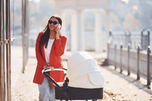 Mother In Red Coat Have A Walk...