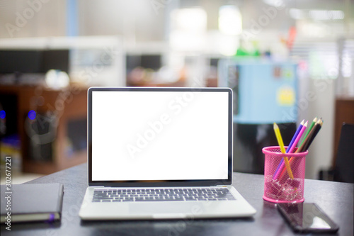 Computer laptop with white blank screen isolated  on work table in office Canvas Print