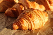 Freshly Backed French Croissants Shiny In The Rays Of The Morning Sun  Close Up