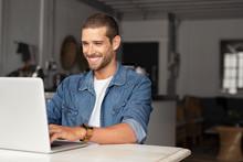 Happy Guy Using Laptop